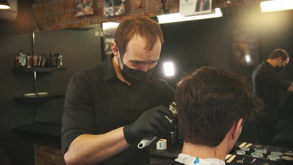 Cover Image for Barber Makes Hair Edging on the Sides of Client with a Hair Trimmer