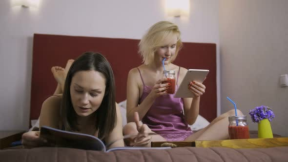 Thumbnail for Cheerful Female Friends Having Fun in Bed at Home