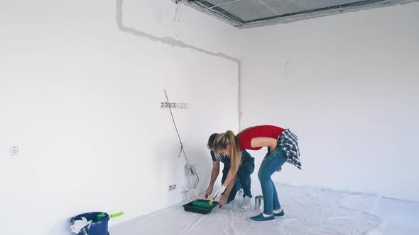 Thumbnail for Happy Man with Pretty Wife Begins Painting White Room Wall