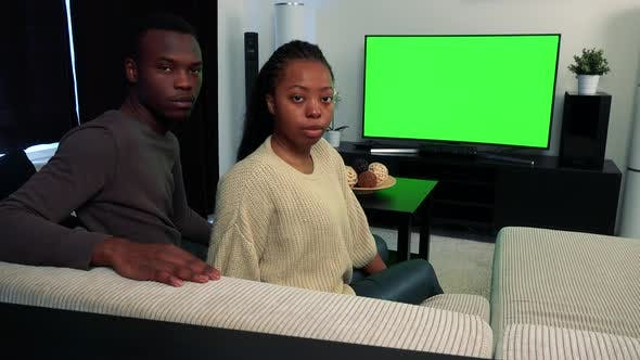 Thumbnail for Young Black Couple Watch Television in Living Room and Then They Disagree