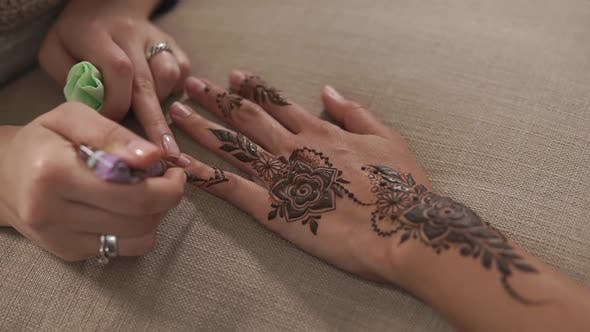 Thumbnail for Close Up Shot of a Woman's Hands, Who Has a Mehendi for a Wedding Celebration