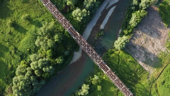 Thumbnail for Train Moving on Bridge Above a River