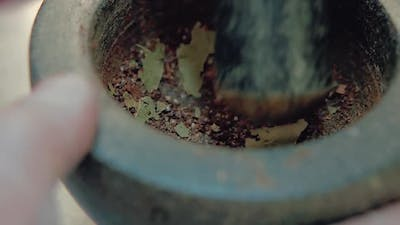 Cook Prepares the Seasoning for the Salad in a Mortar 3