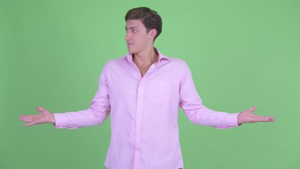 Thumbnail for Confused Young Businessman Shrugging Shoulders