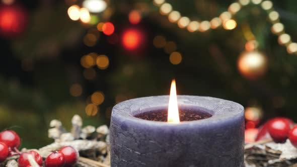 Christmas festive decoration with lit candle