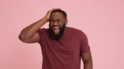 Young African American Man Scream Got Headache Isolated on Pink Background
