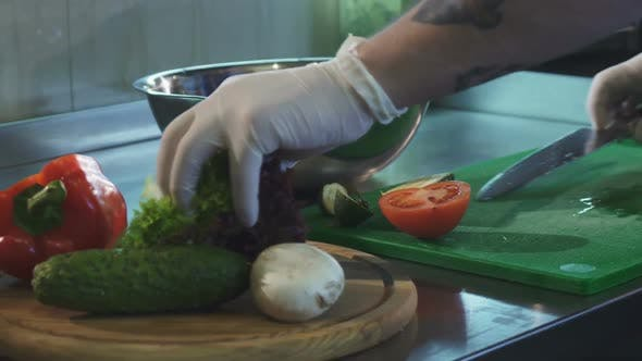 Thumbnail for Cropped Shot of a Chef Preparing Salad at the Kitchen