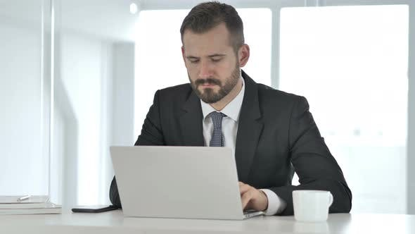 Cover Image for Businessman Working On Laptop