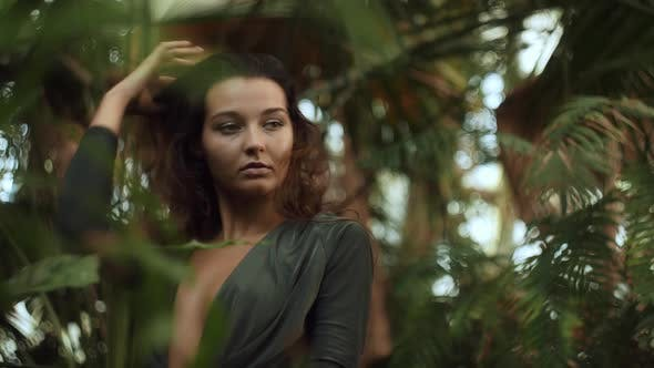 Woman Standing in the Tropical Jungle at Summer