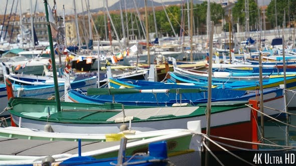 Thumbnail for 4K Colorful Sailing Boats and Fishing Boats in a Marina Harbor
