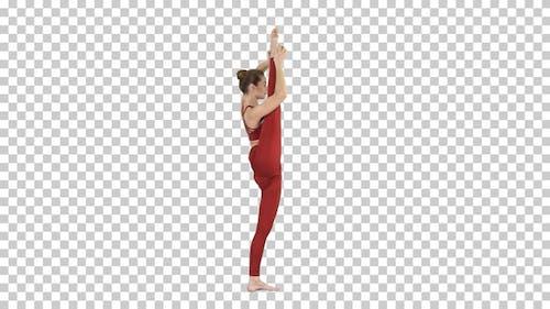 Young yogi woman practicing yoga concept Variation of Utthita