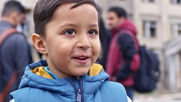 Thumbnail for Smiling Refugee Boy Talking