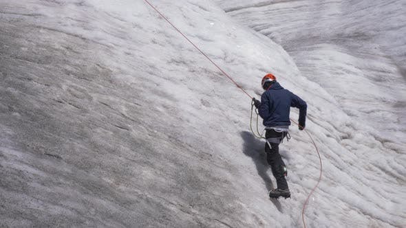 Thumbnail for Mountaineer Man in Crampons Is Using Jumar on Fixed Rope