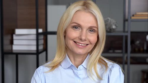 Smiling Confident Middle Aged Business Woman Looks at Camera Portrait