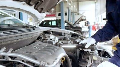 Car Mechanic Work in a Car Repair Shop