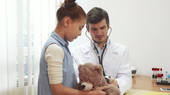 Thumbnail for The Good Doctor Is Listening Through a Stethoscope Girl s Soft Toy