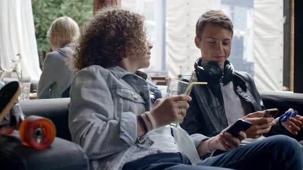 Thumbnail for Teenagers Using Gadgets in Outdoor Cafe