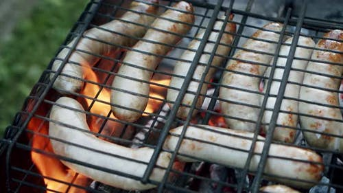 Sausages Are Fried on an Open Fire, Close Up Slow Motion V3