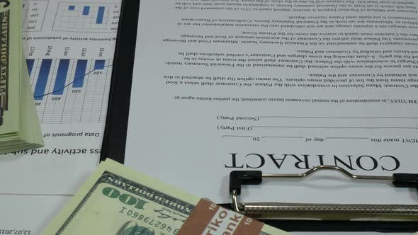 Thumbnail for Business Contract And Dollars In The Modern Office Of The Company