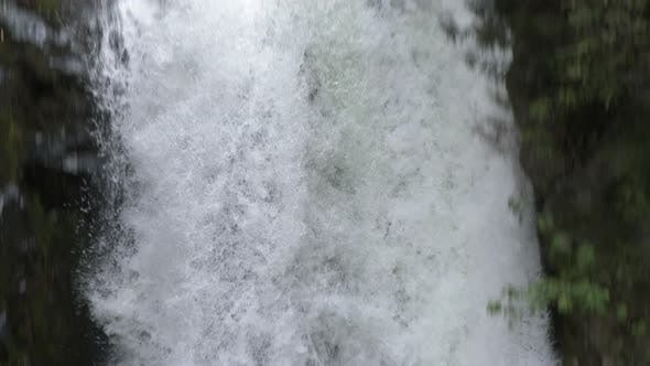 Thumbnail for Slow Motion Waterfall Water Falls Down Steep Slope