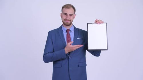 Happy Bearded Businessman Showing Clipboard and Giving Thumbs Up