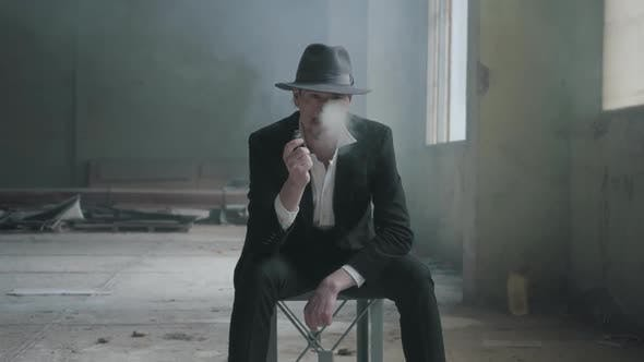 Thumbnail for Mature Man Siting in the Chair in the Destoyed Dirty Place with a Fedora Hat and a Classical Suit