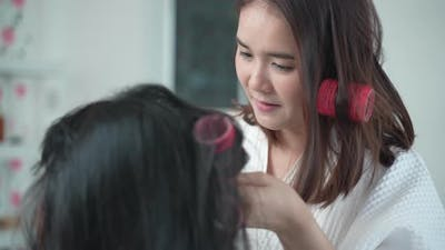Mother and daughter play make up with cosmetics at home. Family activity in beauty fashion concept.