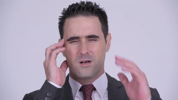 Cover Image for Face of Stressed Businessman Having Headache