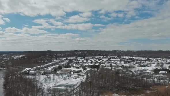 Drone Footage Flying Small Town Neighborhood Trees Covered with Snow Homes