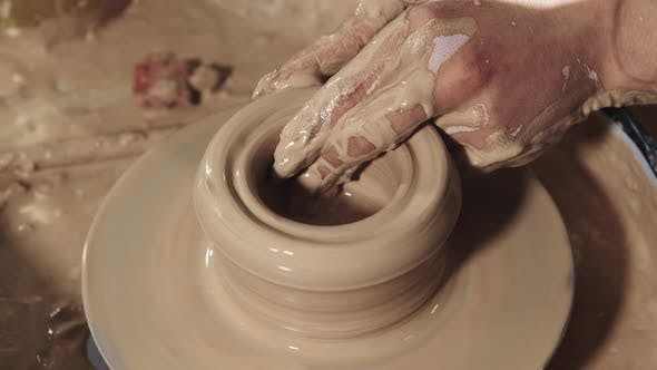 Pottery Crafting  Hands Forms Clay in the a Pot Shape