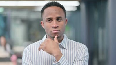 Pensive Young African Businessman Thinking