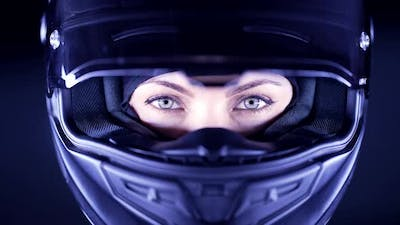 Portrait of Confident Motorcyclist Woman in Closed Motorcycle Helmet