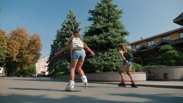 Young Teenage Girls Rollerblading