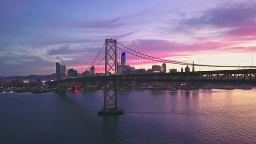 San Francisco aerial video of skyline and Bay Bridge at Sunset