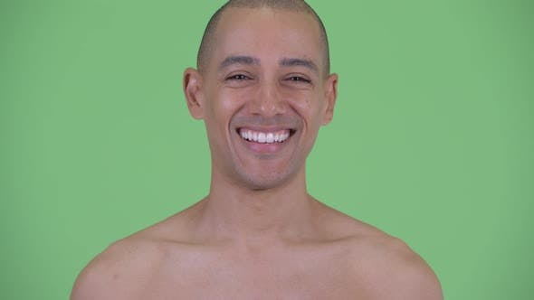 Face of Happy Bald Multi Ethnic Shirtless Man Smiling