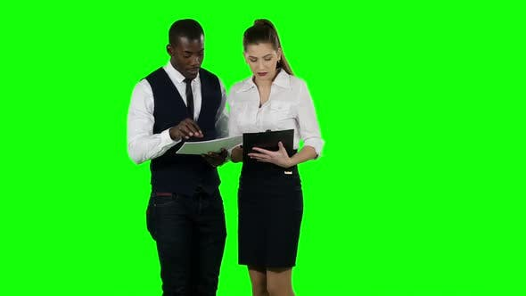 Thumbnail for Businessman Shows a Woman New Information. Green Screen