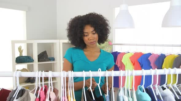 Thumbnail for African American woman shopping for clothes