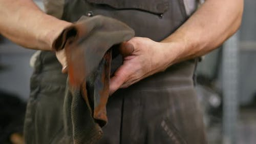 Crop Serviceman Wiping Hands with Napkin