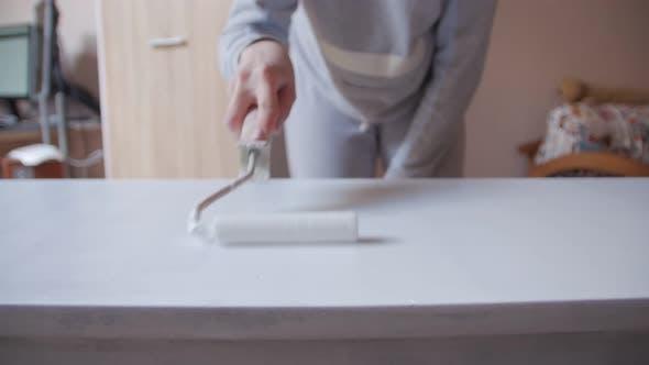 Woman Paints Cabinet