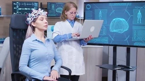 Female Doctor in Neuroscience Checking Brain Data on Her Laptop