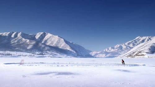 Hockey player on a frozen lake.