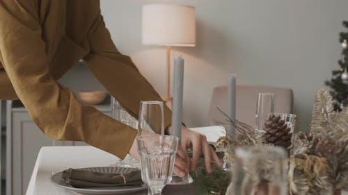 Lighting Candles on Christmas Table