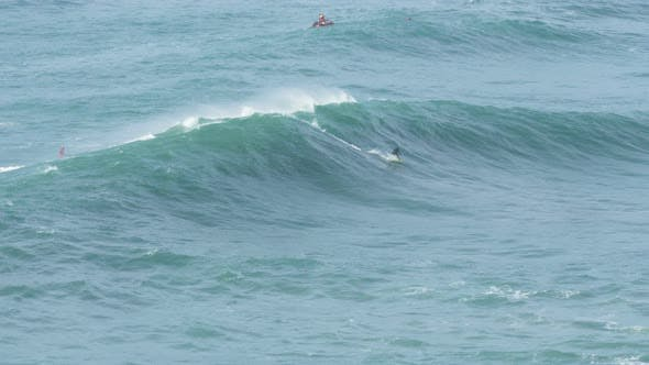 Thumbnail for Rider on Scooter Pulls Surfer and Throws Rope on Huge Wave