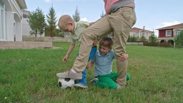 Thumbnail for Lovely Kids and Daddy Playing with Soccer Ball