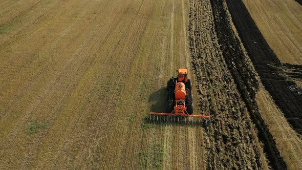 Tractor Plows the Land with a Special Plow