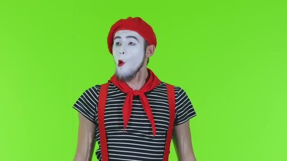 Thumbnail for Mime Man Dresses A Mask On A Green Background