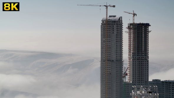 Thumbnail for Skyscraper Constructions Rise Above the Fogs