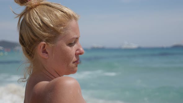 Thumbnail for Resting on the beach 4K 2160p 30fps UltraHD footage - Beautiful blonde girl on the French coast  384