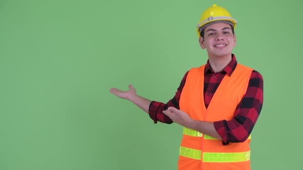 Thumbnail for Happy Young Multi Ethnic Man Construction Worker Showing To the Back