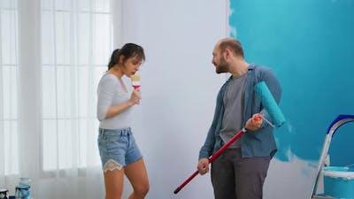 Girl Singing on Paint Brush